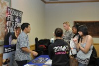 Students gather around the FBI table at last semester's Career Fair.