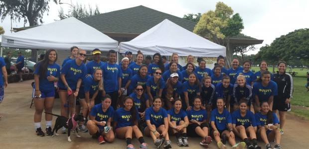 Joined by the women's soccer team, the Chaminade softball girls came together to support their coach George La Rosa in a memorial walk for his daughter.
