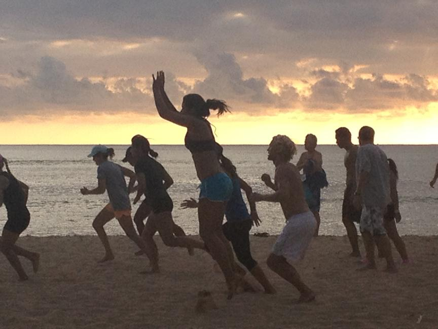 Randy Morris' students doing high jumps and sprints during Beach Boot Camp.