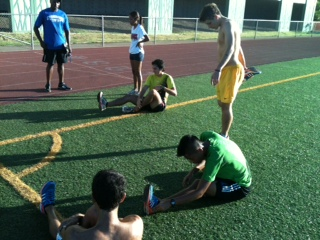 The Chaminade Cross Country team makes time to stretch after an intense track workout.