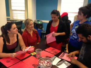 Student Support Services staff members, Julie Tarter and Danielle Russell, talking to students about information on cardiovascular disease.