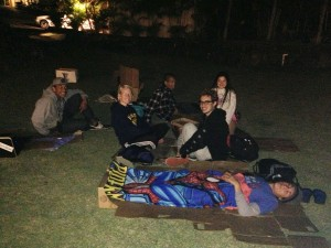 Students hanging out and sleeping on cardboard boxes. Photo by Tawnee Rollerson.