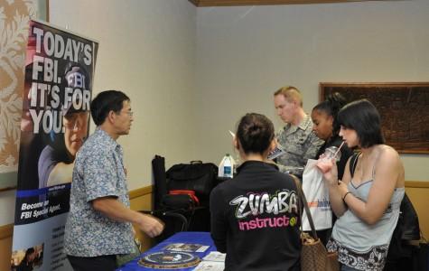 Students gather around the FBI table at last semester's Career Fair.