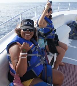 My roommate and I, Brittany Talamantes, cruising on the boat. Photo courtesy of Hawaiian Parasailing Inc.