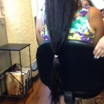 Ten inches of hula hair banned together to get cut and donated.