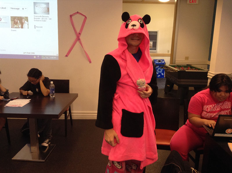 Chaminade student Adam Brewer, Junior shows his pink pajamas in celebration of breast cancer awareness