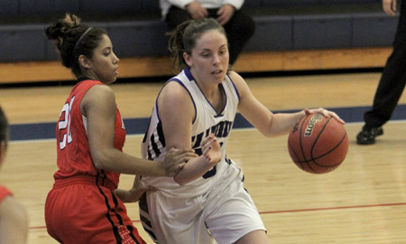 Hannah Curtis aggresively drives to the basket  Photo by: Kevin Hashiro