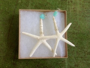 The large white starfish earrings are the signature piece of Aydee by the Sea. Photo Credit: Melanie Schumilas