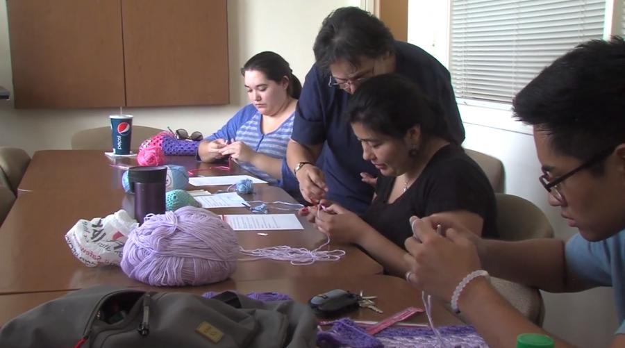 Caring Crocheter knitting for USO newborn babies