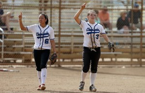 Infielders Kristian Endow and Jenn Beitian signal the number of outs. Photo Courtesy of Chaminade Athletics