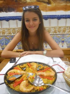 Bucher dining in Madrid, Spain eating one of it's popular traditional dish called the Paella.