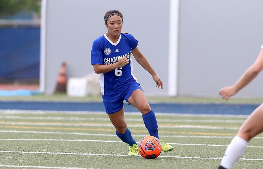 Kristen Fujinaga dribbles the ball and breaks through the midfield against Westminister (Utah).