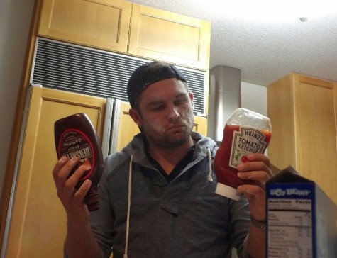 Ches Bond deciding on which sauce to use in his meal.