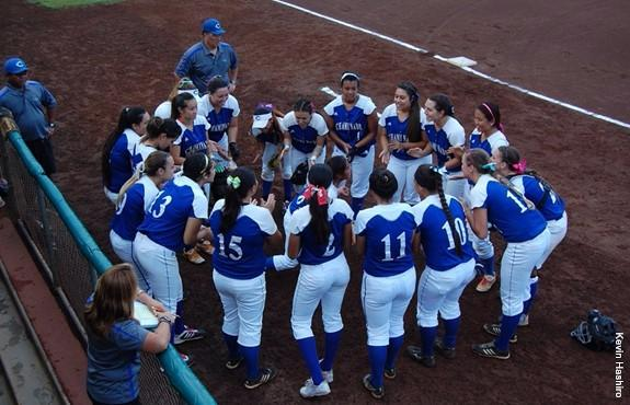 Chaminade womens softball in a huddle at the UH tournament last season in November.