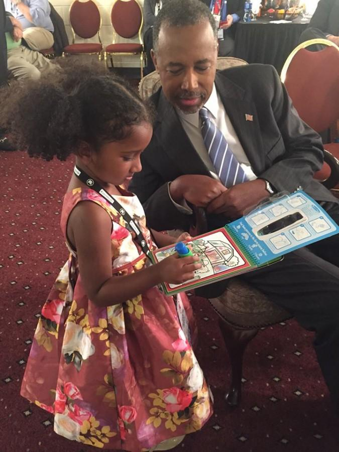Dr. Ben Carson is enjoying time with his granddaughter before a debate.