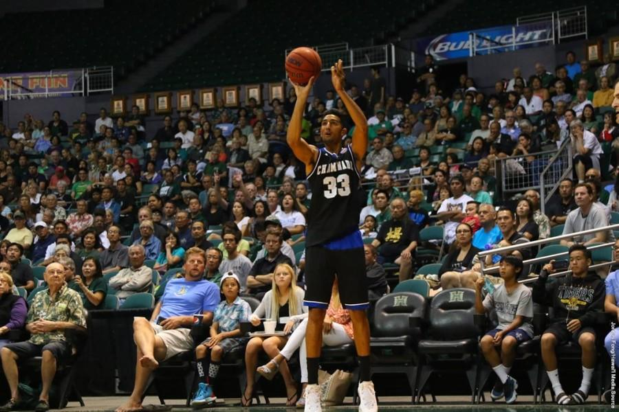 Kiran Shastri shooting a 3-pointer against University of Hawaii at Stan Sheriff Center.