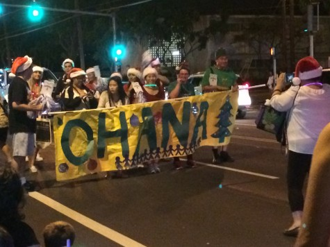 Chaminade's Ohana Club proudly paraded down Waialae Avenue during the 69th Annual Kaimuki Christmas Parade.