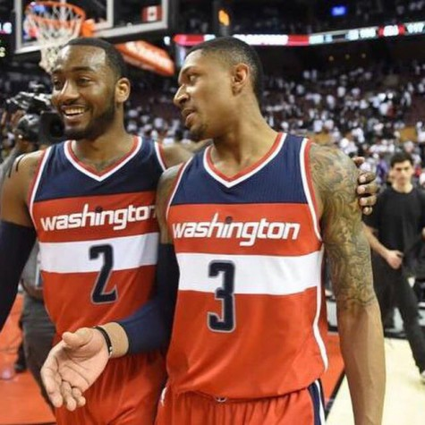 John Wall (left) looks to improve his jumpshot to solidify himself as a top point guard in the NBA