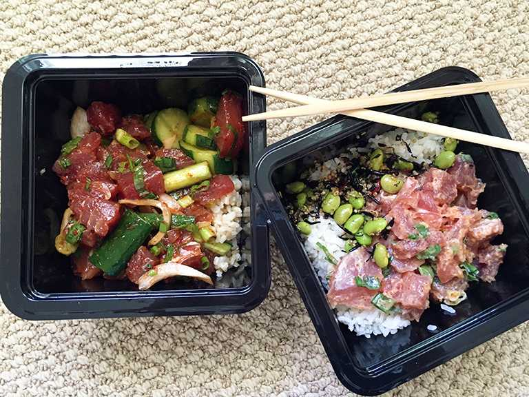 Two+House+Favorite+Poke+Bowls.+Left%3A+Korean+style+ahi+poke+with+brown+rice+and+a+side+of+kim+chee+cucumber.+Right%3A+Spicy+ahi%2C+white+rice+and+a+side+of+quinoa+salad.