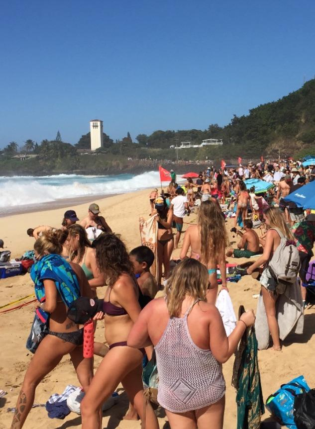 Waimea Bay was so crowded on Wednesday that people began to ignore the caution tape.