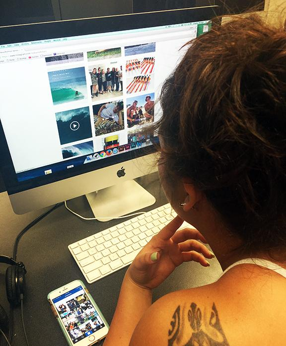 Waihilo, an avid user of social media browses her Instagram on both her iPhone and computer.