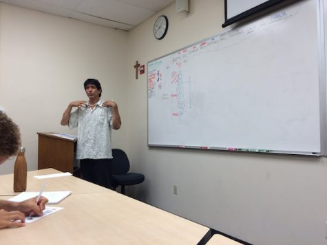 Kumu Keahi sharing a lesson in his Hawaiian Oral and Religious Tradition class.