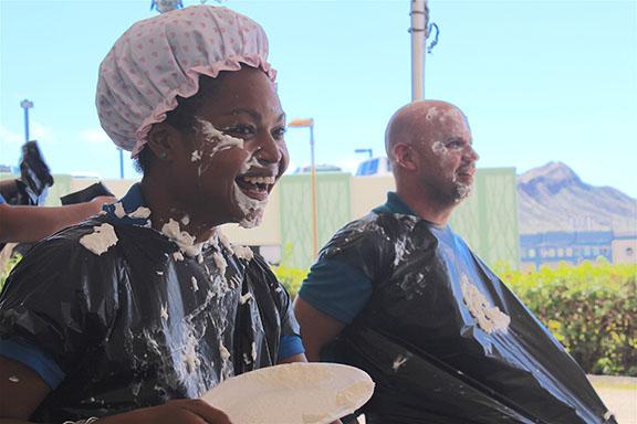 Sahtiya Hammel (left) and Danny O'Reagan volunteered for the pie tossing booth.