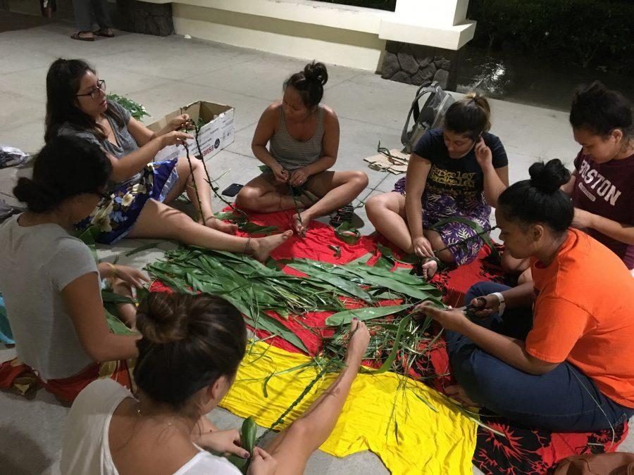 Members of the Temana Tahitian club prepare for PIR by making adornments with ti leaves.