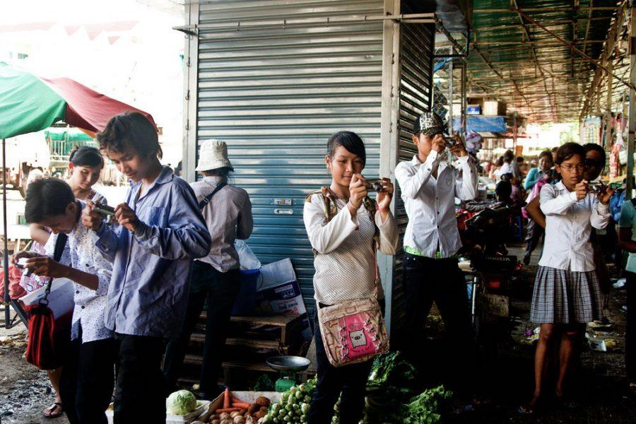 Jen May's students use their photography skills in a Cambodian Market.