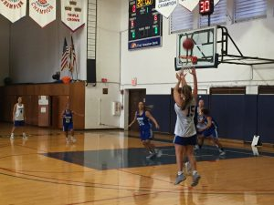 Sarah Dudzinski shooting a Three-Pointer during CUH practice while working on their offense