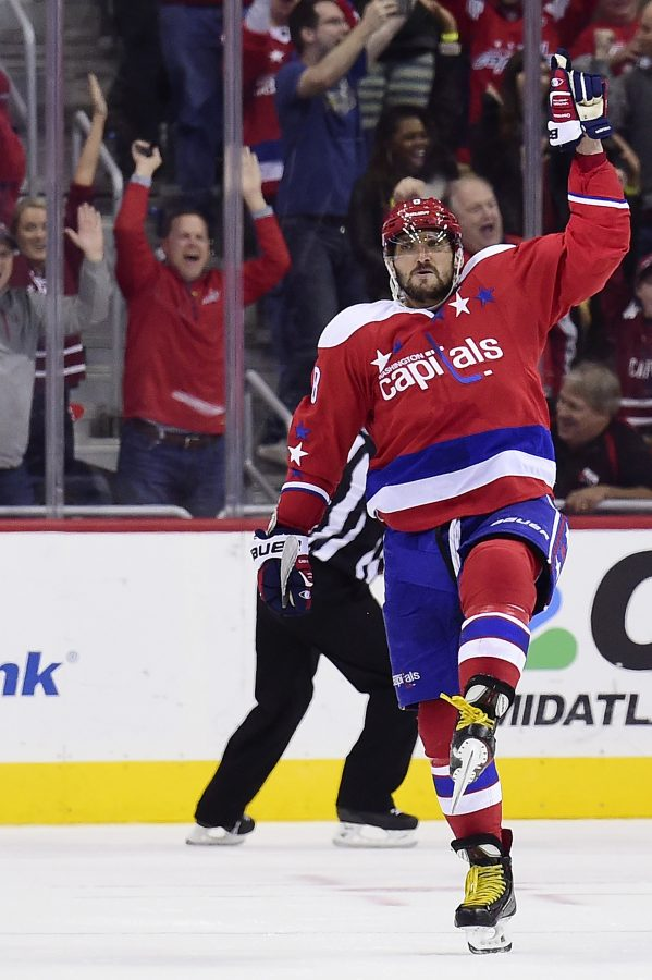 Alex Ovechkin #8 and captain of the Washington Capitals has 977 points in 853 regular season NHL games
