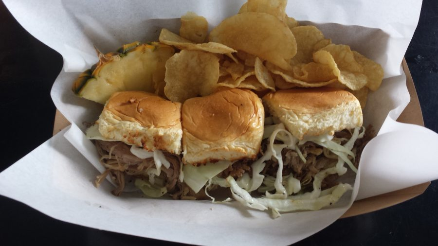 Kalua Pig Sliders served with maui-style chips and a slice of pineapple