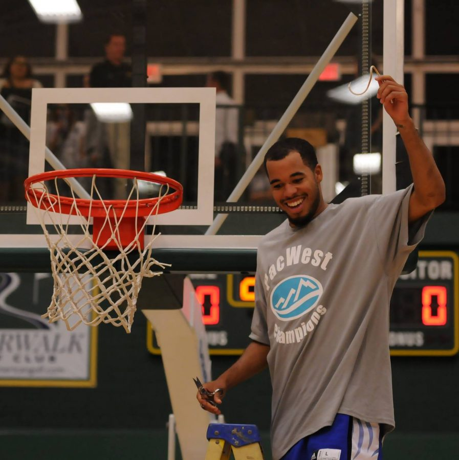 Lee Bailey celebrates the Pac West Championship.