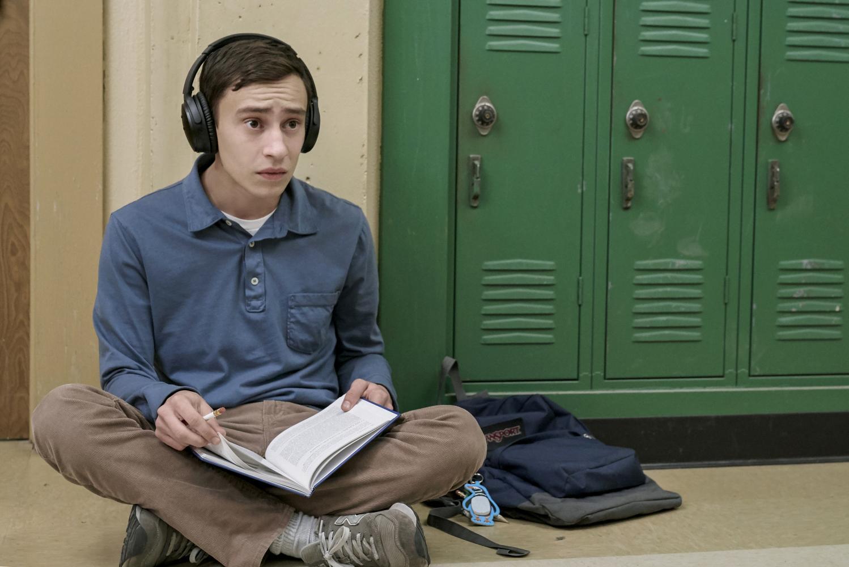 Sam wears headphones in public to avoid sensory overload.