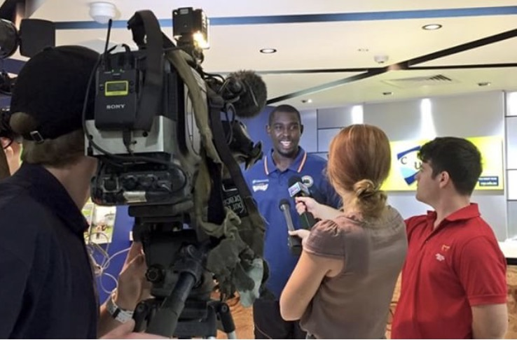 Kuany takes questions from the Australian media.