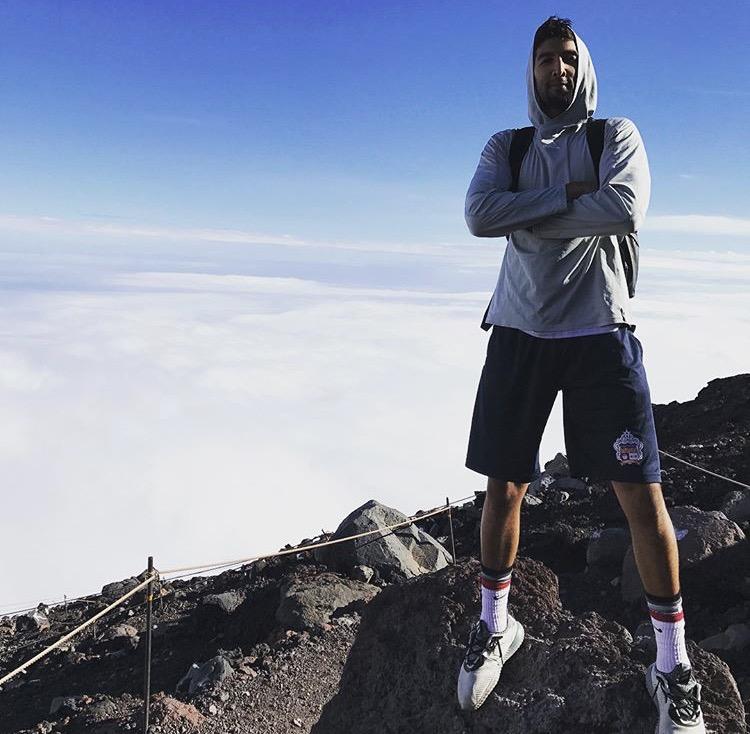 Former Silversword Kiran Shastri at the top of Mount Fuji in Japan.
