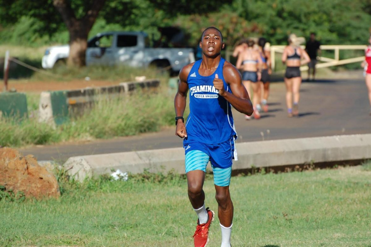 Antonio Bonnetty pushing through pain to finish the last mile of a cross-country race at Sand Island in Honolulu