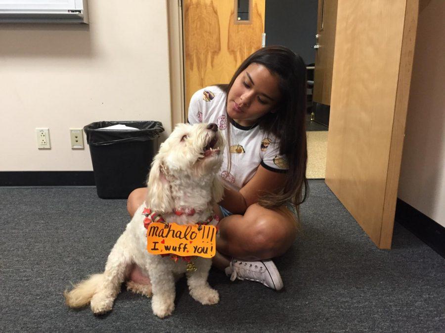 Marlo, giving senior Sam Brooks one more hug on his last day on campus.