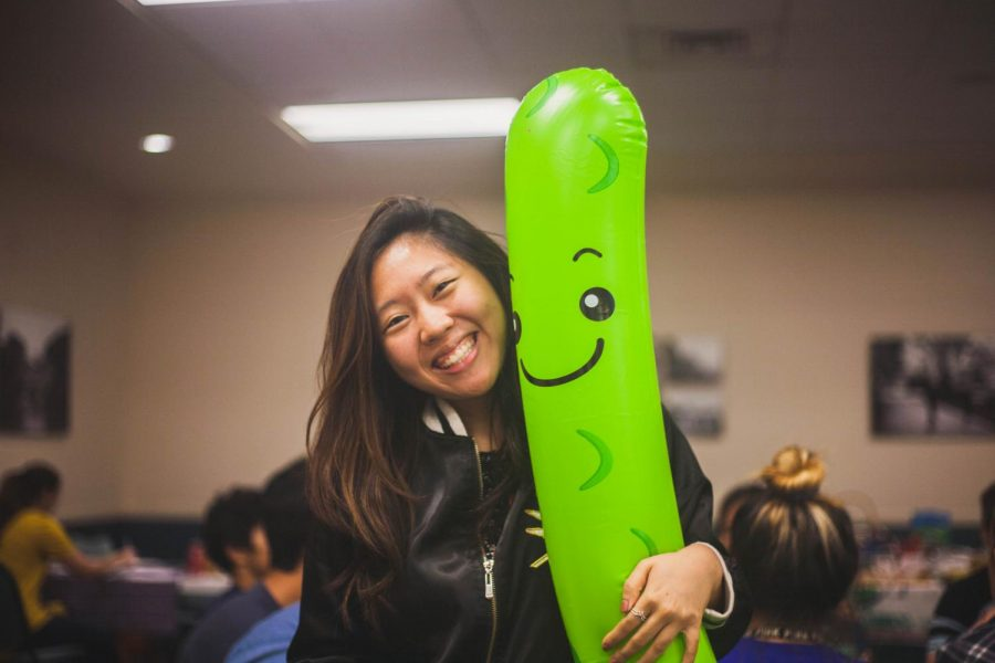 Mikayla Poon poses with inflatable pickle, which was a popular prop at the photo booth.