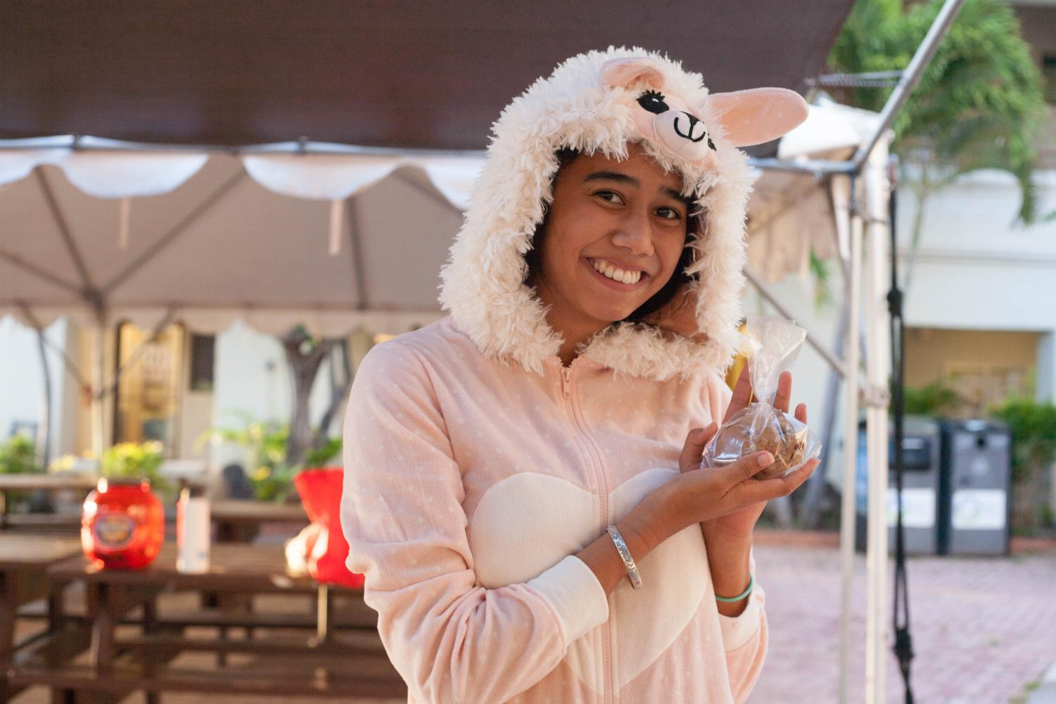 Kaohi Gomera dressed up as a lamb for Halloween and showed one of the treats for sale at the RHA booth.