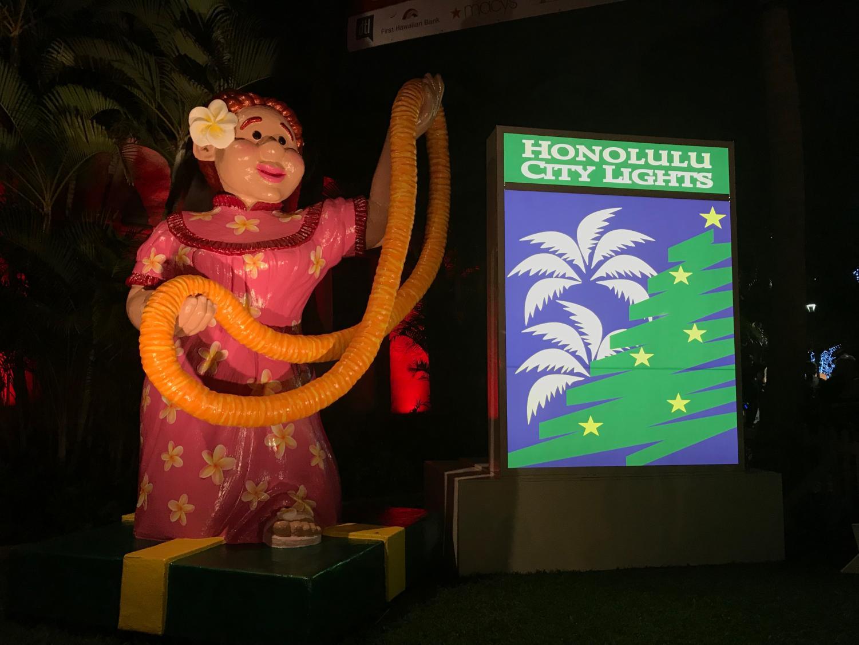 Oahu's city lights parade showcases the aloha spirit mingled with holiday cheer.