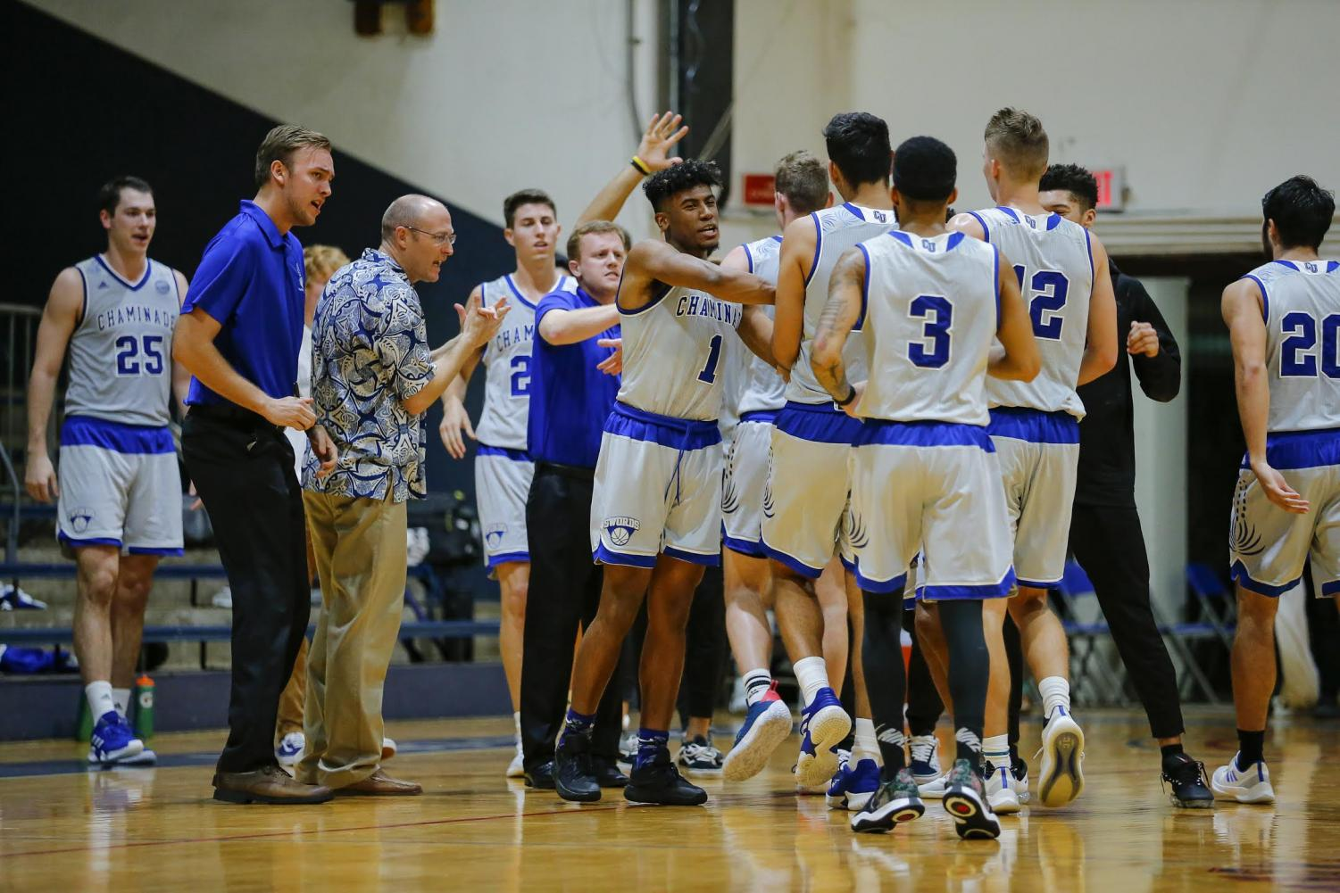 Men's Basketball team celebrates win against Biola. Courtesy of Kevin Hashiro.