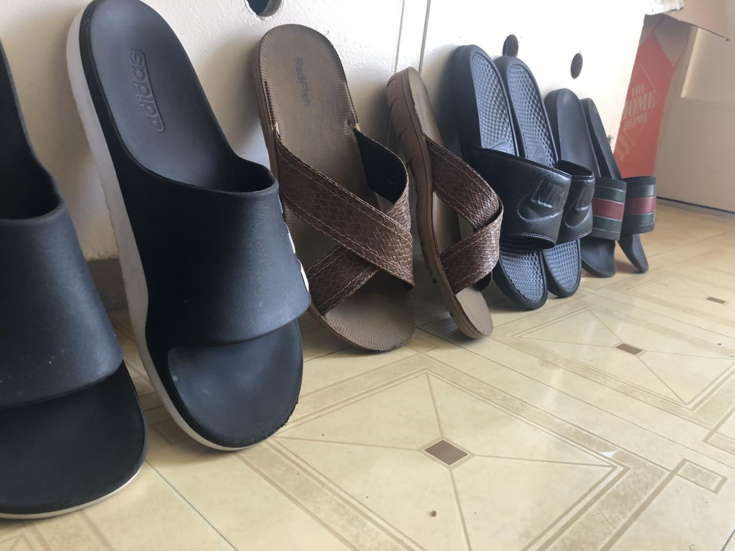 Slippers lined up inside an apartment