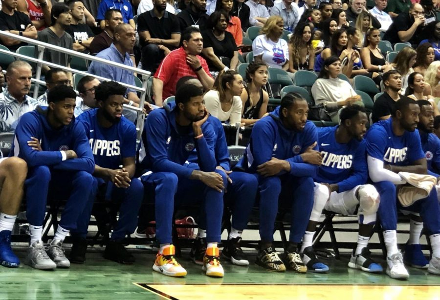 Clippers head coach Doc Rivers sat star forwards Paul George (second from left) and Kawhi Leonard (second from right) at the team's opening preseason game against the Houston Rockets on Thursday.