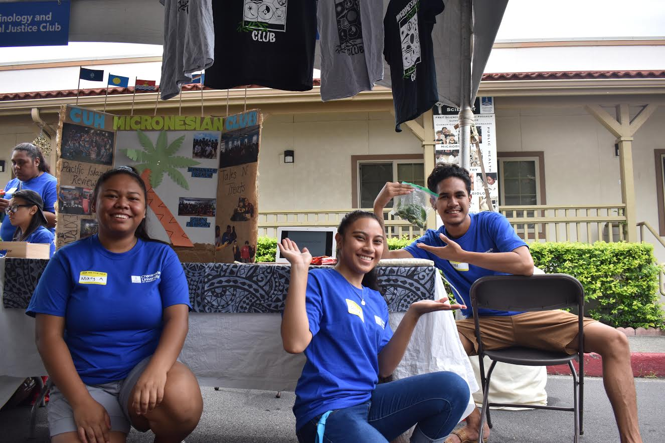Students Mary Anton, Sisca Aaron, Kobe Ngirailemesang (from left to right) who are all members of Chaminade's Micronesian Club, helped at Preview Day on Saturday by sharing information to interested high school students about the club.