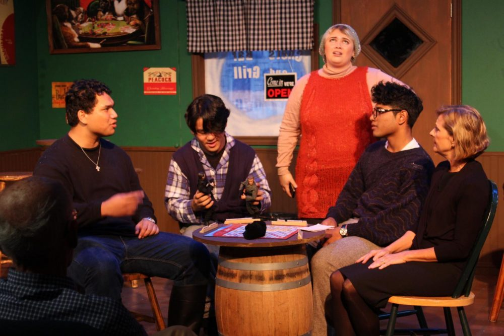 Eddie, Georgie, Annie, Rudy, and Ellen (left to right) discuss the significance of religion over a game of Scrabble during the opening night of performance of
