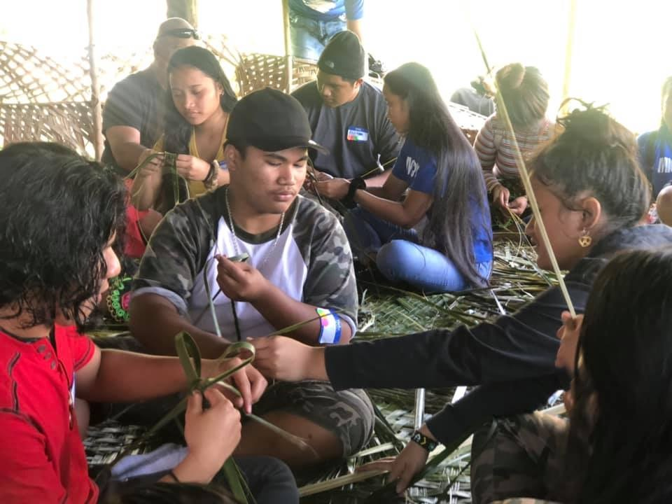 Students were taught to weave under an outdoor Chuukese hut that the island calls an