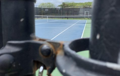 Chaminade University's empty tennis court remains locked during midst of coronavirus concerns.