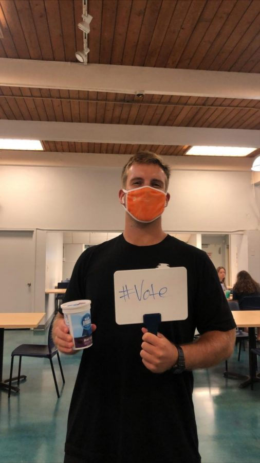 After showing proof of voting, CUH undergraduate student, Dominic Coffey received his ice cream at the new Voter Registration Drive.