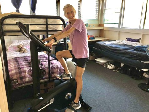 Hannah Harvistol, who is on the Chaminade cross country team, is keeping in shape by riding her exercise bike.
